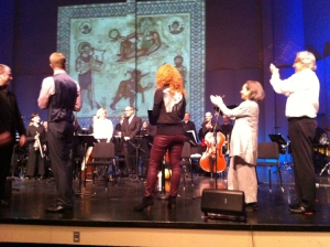Left to right: singers Gregory Gerbrandt and Abigail Fischer, Miriam and Kamran clapping for the orchestra