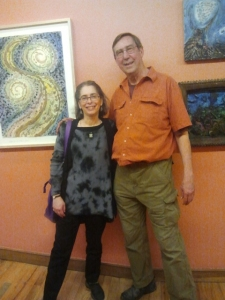 Me and artist Peter Kinney - a painting by Peter on left, and one by Jeff Waring on right